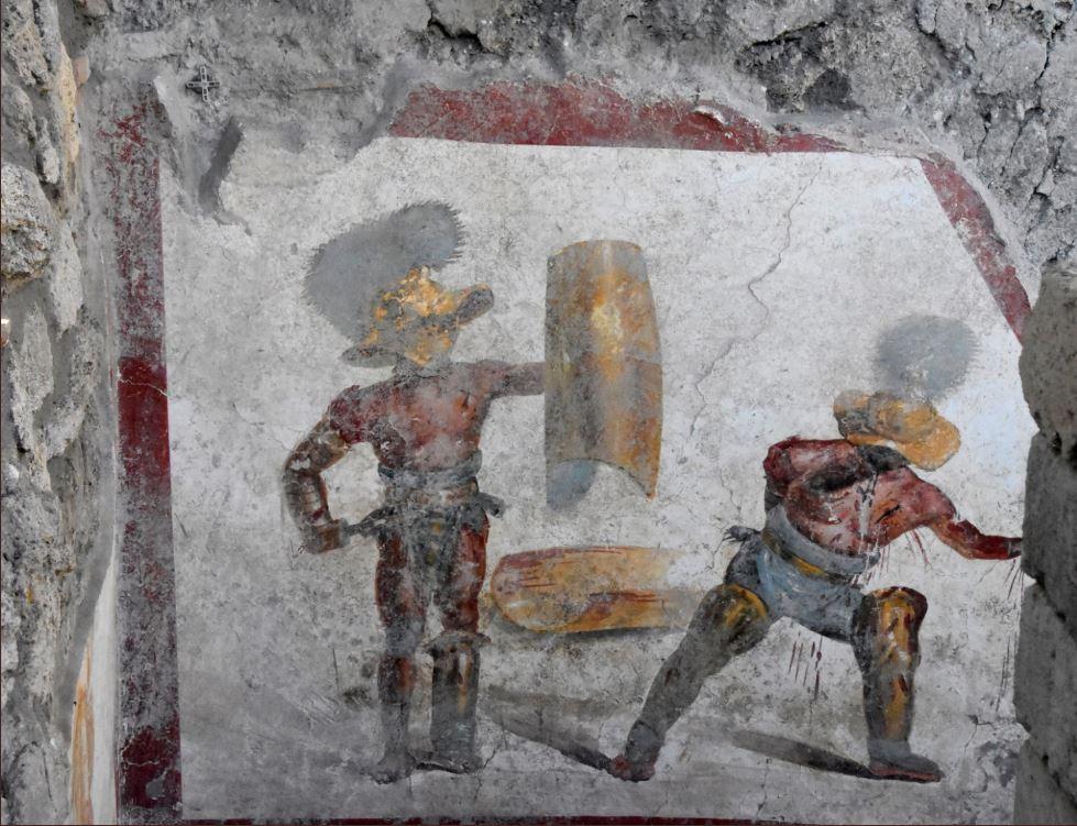 Pompei svela un altro capolavoro: l'affresco dei gladiatori